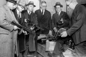 Primed for warfare, Chicago gangsters forced police to equip themselves with miniature arsenals to cope with gang wars. Deputy Chief Stege (right) hands out machine guns to detectives while Chief of Detectives Shoemaker (fourth from left) looks on, January 09, 1927. (Photo by NY Daily News Archive via Getty Images)